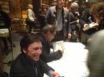 Peter Kuznick and Oliver Stone signing books